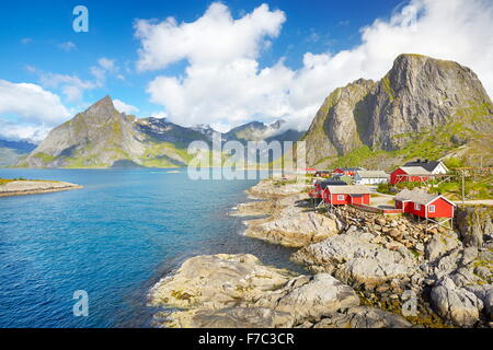 Traditional red wooden fishermen`s huts rorbu, Lofoten Island landscape, Norway - Stock Photo