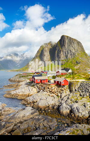 Red wooden fishermen`s huts rorbu, Lofoten Island landscape, Norway - Stock Photo