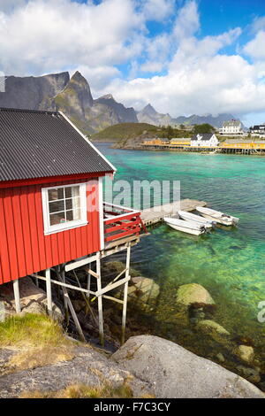 Traditional red wooden fishermen`s cottage, Lofoten Island, Norway - Stock Photo