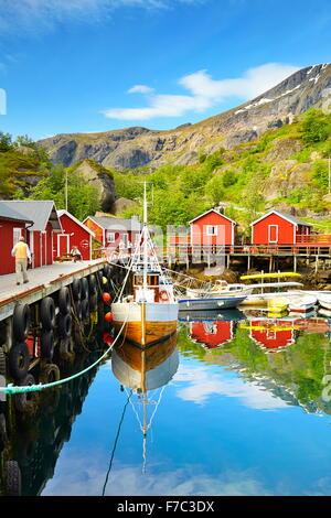 Lofoten Islands, harbour with red fishermen's hut, Nusfjord, Norway - Stock Photo