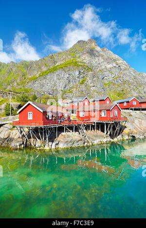 Traditional red wooden rorbu huts on Moskenesoya Island, Lofoten Islands, Norway - Stock Photo