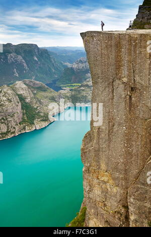 Landscape with single tourist on the Pulpit Rock, Preikestolen, Lysefjorden, Norway - Stock Photo