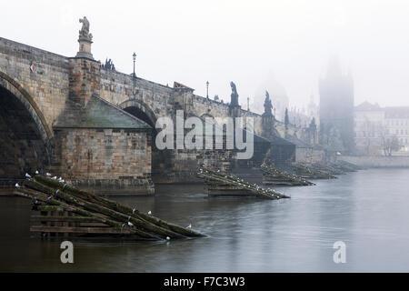 Czech Republic, Prague, Charles Bridge during typical fog autmn atmosphere - Stock Photo