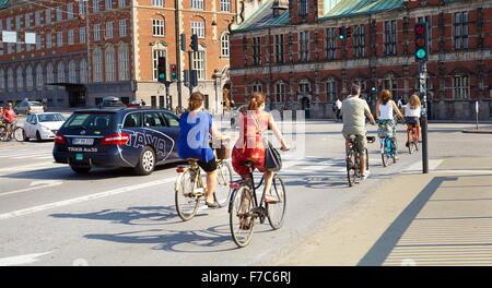 Riding bicycles on the Copenhagen street, Denmark - Stock Photo