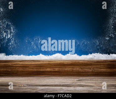 Winter window with frost patterns in the night. Focus on the windowsill. - Stock Photo