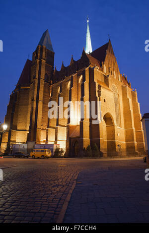 Church of the Holy Cross and St Bartholomew at night in Wroclaw, Poland. - Stock Photo