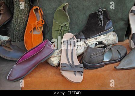 A selection of medieval shoes available for purchase at the Medieval Fair in Silves, Portugal. - Stock Photo