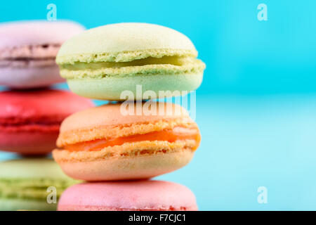 French Macaroons On Blue Background - Stock Photo