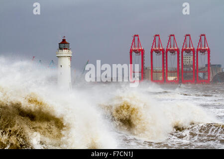 Danger wave sea wall. New Brighton, Wirral, UK 29th November, 2015.  UK Weather Fort Perch lighthouse, Force winds - Stock Photo