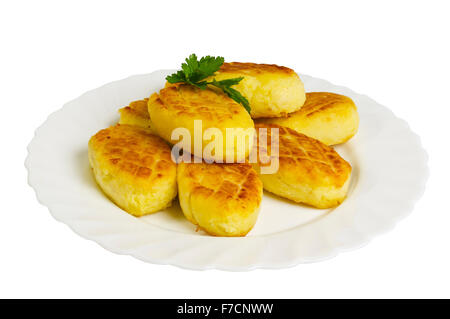potato cakes with mushrooms on the plate, isolated on white background - Stock Photo