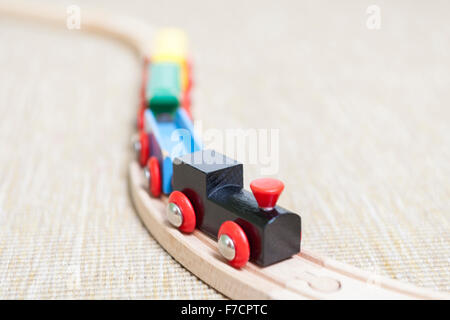 Wooden toy train set for children on train track  Model Release: No.  Property Release: No. - Stock Photo