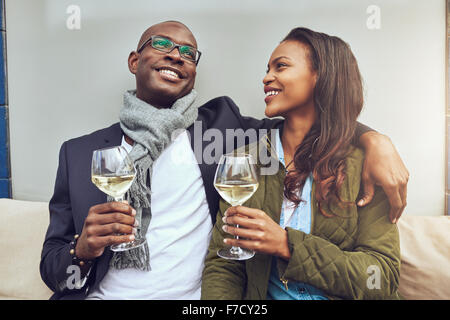 Black couple having a good time drinking a glass of wine - Stock Photo