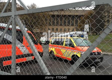 Berlin, Germany. 29th Nov, 2015. Ambulance vehicles and police cars parked at the former Tempelhof airport in Berlin, - Stock Photo