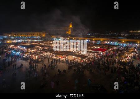 View of the Jamaa el Fna in Marrakech, Morocco at night - Stock Photo
