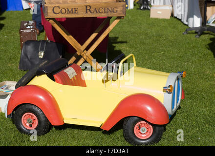 Toy Noddy Car with a come racing wooden box table on a bric and brac stall - Stock Photo