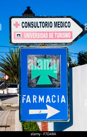 Sign in a Spanish town for the Farmacia (pharmacy/chemists) - Stock Photo