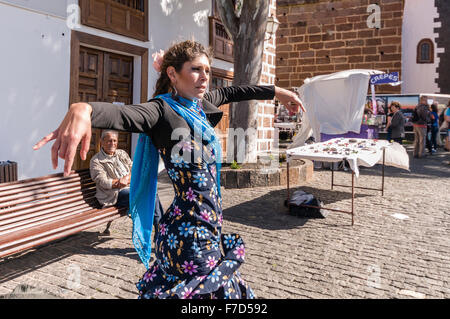 A Spanish lady entertains at the Sunday Market in the Lanzarote town of Teguise with traditional Spanish flamenco - Stock Photo