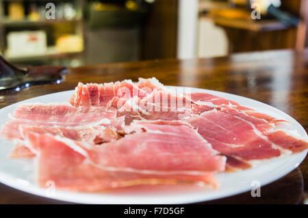Spanish ham (Jamón ibérico, Iberian ham, pata negra) cured ham served as a tapas in a bar - Stock Photo