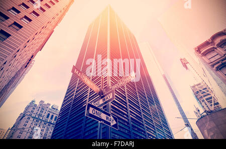 Retro old film style photo of street signs in Manhattan, NYC. - Stock Photo