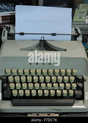 Antique Triumph Adler Gabriele20 mechanical typewriter with paper - Stock Photo