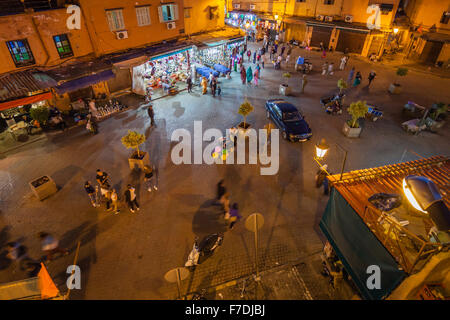 Night Square Marrakesh medina with the last tourists - Stock Photo