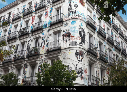 TODO ES FELICIDÁ,  ALL IS HAPPINESS,  A mural painted by artist Jack Babiloni on both facades of a 19th cen. building - Stock Photo