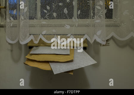 Royal Mail delivery of letters, packets and jiffy bags to a residential home - Stock Photo