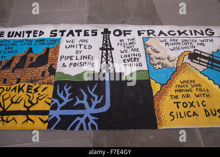 New York, United States. 29th Nov, 2015. A detail of a fracking-themed banner used in the Climate March. On the - Stock Photo