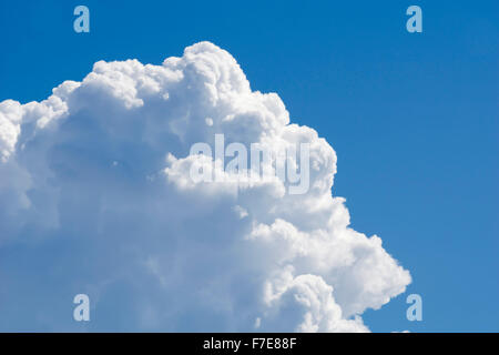Big white cloud against blue sky - Stock Photo