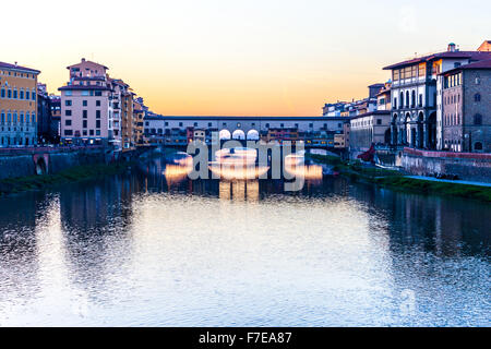 Ponte Vecchio is one of the most famous bridge in the world, visited by million of tourists every year, Florence, - Stock Photo