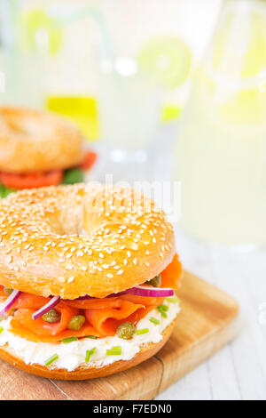 A bagel with salmon, cream cheese and capers. Photographed in bright light with a shallow depth of field. - Stock Photo