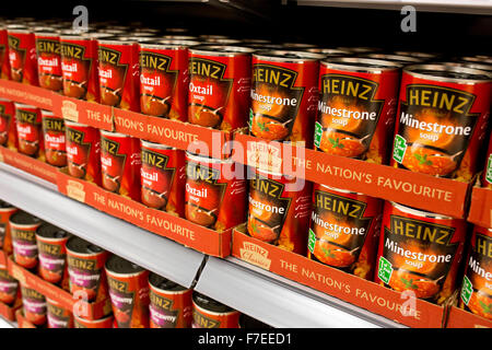 tins of Heinz  soup on supermarket shelves - Stock Photo