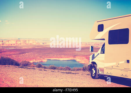 Vintage toned RV (camper) parked by canyon, family vacation concept, Lake Powell, USA. - Stock Photo