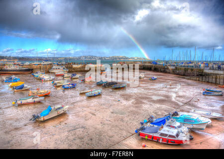 Rainbow English harbour paignton Devon England uk in colourful HDR with boats at low tide and view to Torquay - Stock Photo