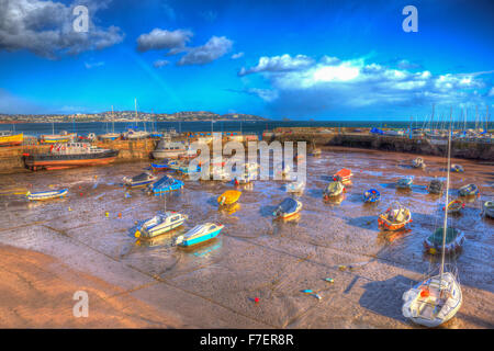 Paignton harbour Devon England uk in colourful HDR with boats at low tide and view to Torquay - Stock Photo