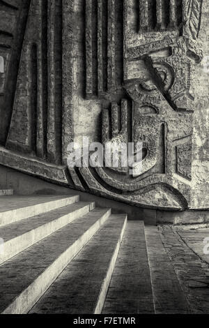 Classical diagonal stairs draw the eye towards a wonderful hand carved stone wall sculptures.  Monochrome Black - Stock Photo