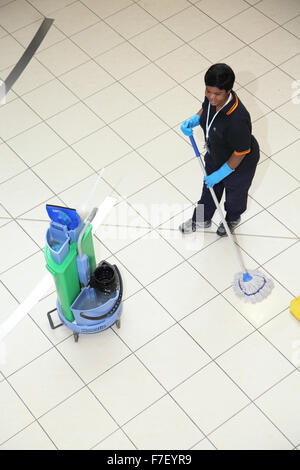 A hospital cleaner mops the floor in a modern UK hospital. Viewed from above. - Stock Photo