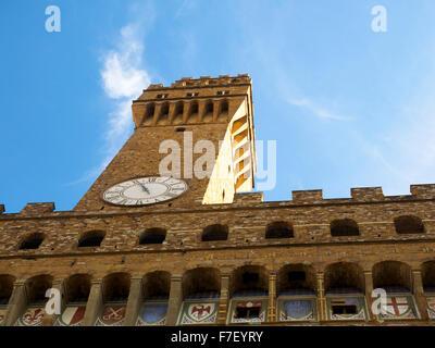 Clock tower of Palazzo Vecchio - Florence, Italy - Stock Photo