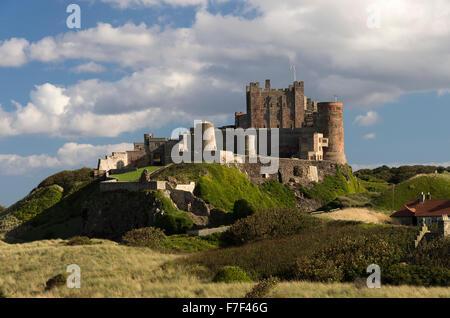 Beautiful Bamburgh Castle Stands On a Dolerite Outcrop Overlooking Bamburgh Village Northumberland England United Kingdom UK Stock Photo