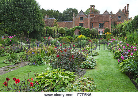 Chenies Manor House and Gardens - English Garden showing the Sunken Garden summer double borders with Dahlia and - Stock Photo