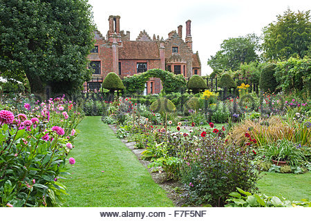 Chenies Manor Gardens - English Garden showing the House and summer Sunken Garden double borders with Dahlia and - Stock Photo