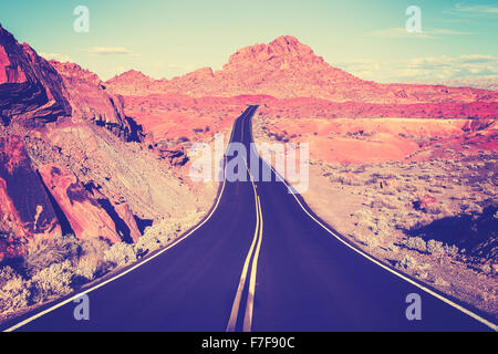 Vintage toned curved desert highway, travel concept, USA. - Stock Photo