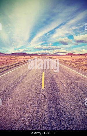 Retro stylized desert highway, travel adventure concept, USA. - Stock Photo