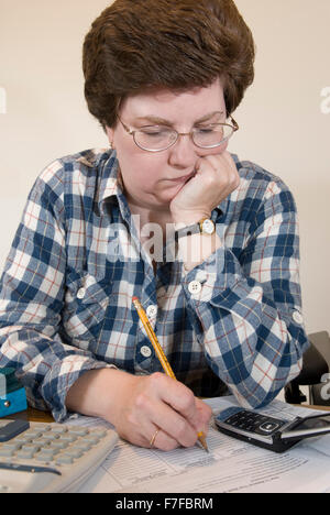 Balancing Bank Balance - Stock Photo
