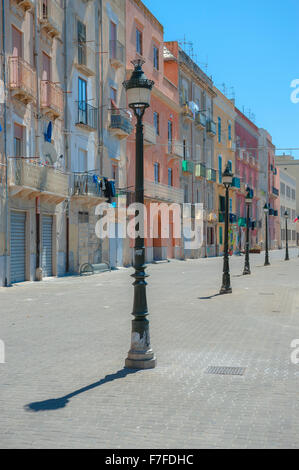 Sicily architecture, pastel-coloured buildings along the quayside in the harbor area of Trapani, Sicily. - Stock Photo