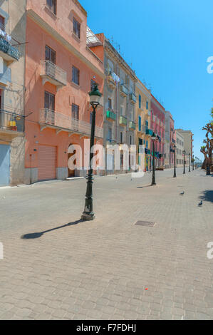 Trapani Sicily, pastel-coloured buildings along the quayside in the harbor area of Trapani, Sicily. - Stock Photo