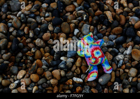 Newhaven, UK. 30th Nov, 2015. A child's toy is left washed-up on a beach in the wake of storm Clodagh at Brighton - Stock Photo