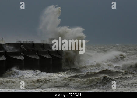 Newhaven, UK. 30th Nov, 2015. Giant waves crash against the harbour wall of Brighton Marina as strong winds continue - Stock Photo
