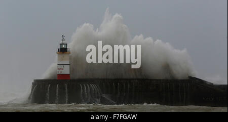 Newhaven, UK. 30th Nov, 2015. Giant waves crash against the Newhaven harbour lighthouse as strong winds continue - Stock Photo