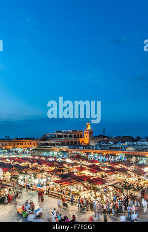 Dusk view of food stalls and crowds in Jemaa El Fna Square in Marrakech, Morocco. - Stock Photo